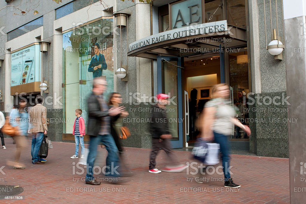 Motion Blur Of Shoppers Passing Storefront In San Francisco stock photo