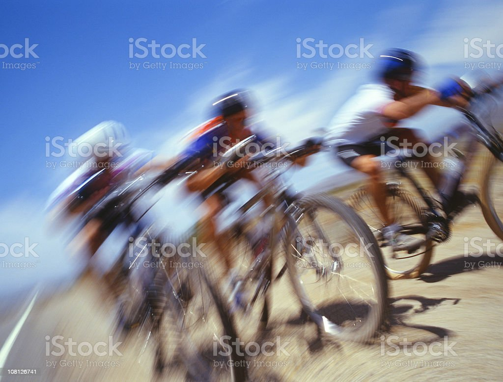 Motion Blur of Three Men Racing on Bicycles During Day royalty-free stock photo