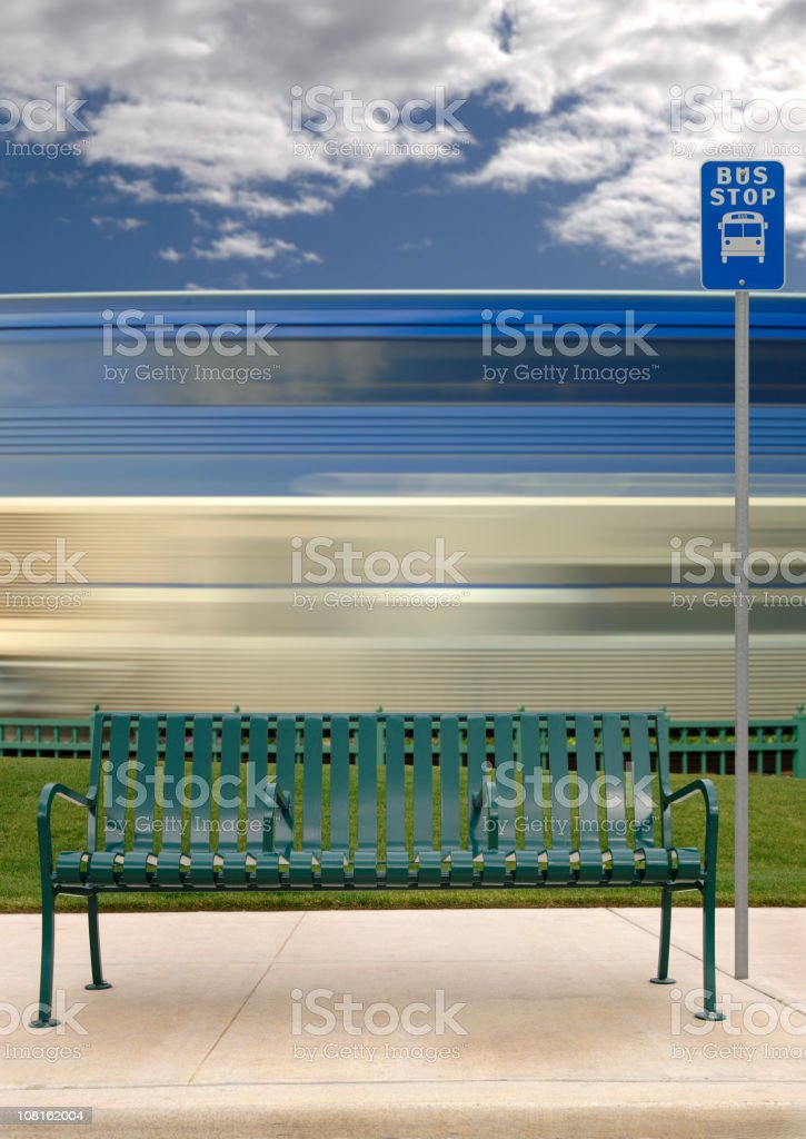 Motion Blur of Train Behind Bus Stop royalty-free stock photo