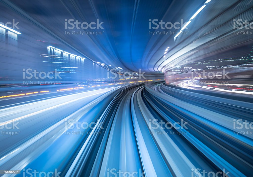 Motion blur of train moving inside tunnel in Tokyo, Japan stock photo