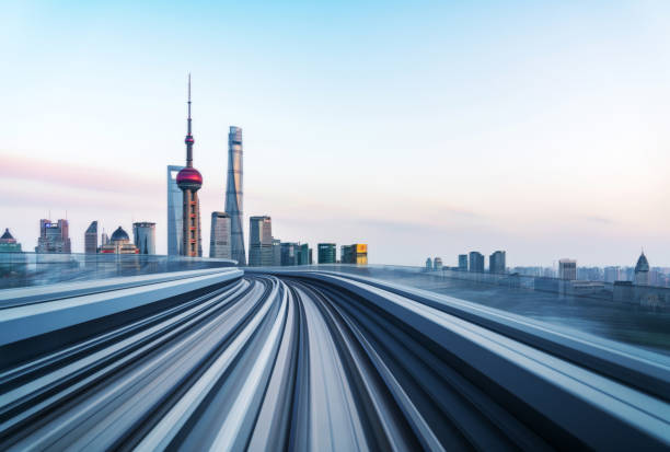 Motion blur of train moving to City Abstract motion-blurred view from a moving train,shanghai,china. bullet train stock pictures, royalty-free photos & images