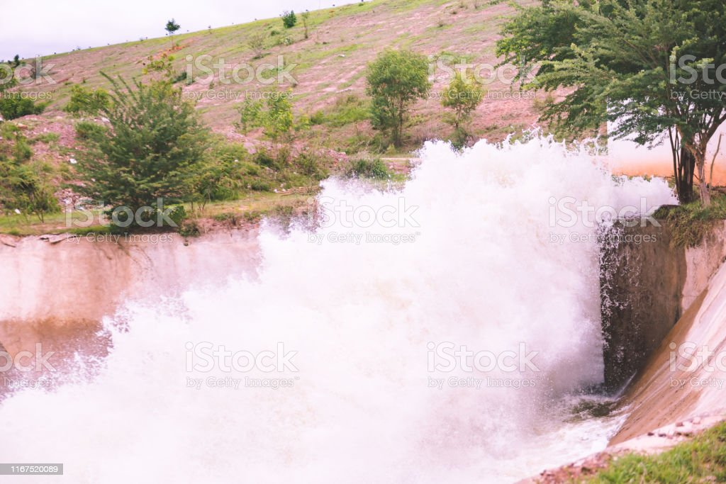 motion blur of waterfall from overflow of dam on rainy season