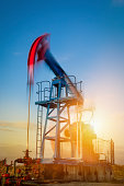 An oil pumpjack pumping on the plains. Long exposure for motion blur.