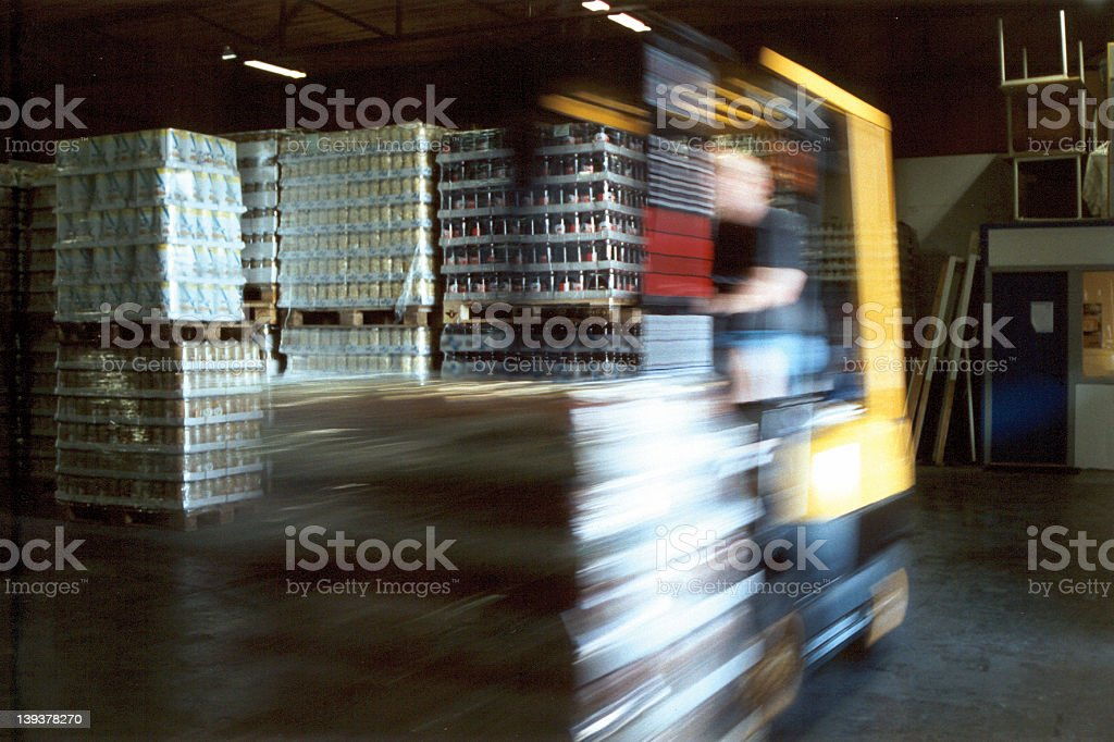Motion blur picture of automobile on warehouse royalty-free stock photo