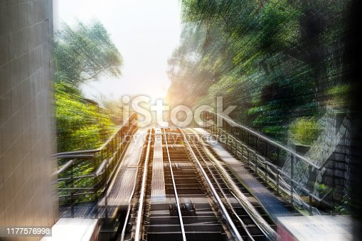 Motion blur railroad track through forest.