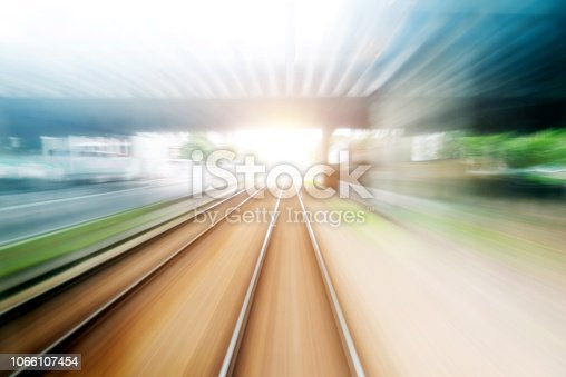Motion blur railway tunnel in city street.