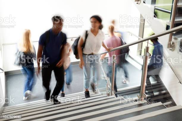 Motion blur shot of high school students walking on stairs between picture id1047529590?b=1&k=6&m=1047529590&s=612x612&h=vmyvzjbmg1jehbqx5xtlrsv1dyrfyzw  yy2h9qpfko=