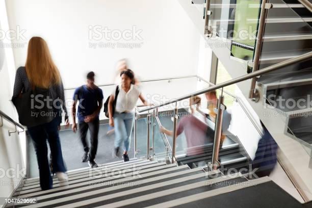 Motion blur shot of high school students walking on stairs between picture id1047529592?b=1&k=6&m=1047529592&s=612x612&h=gajze57nxwsbxfdoyeu6p8uf9bf hdb7sj 00j fdoc=