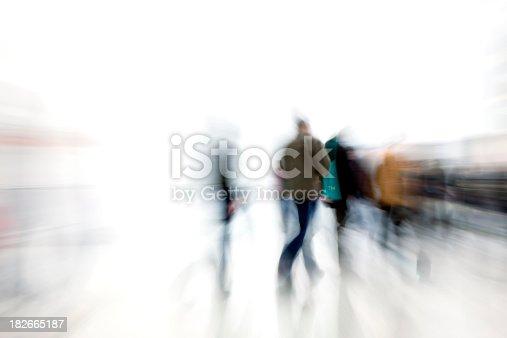 istock Motion blur shot of people rushing in corridor 182665187
