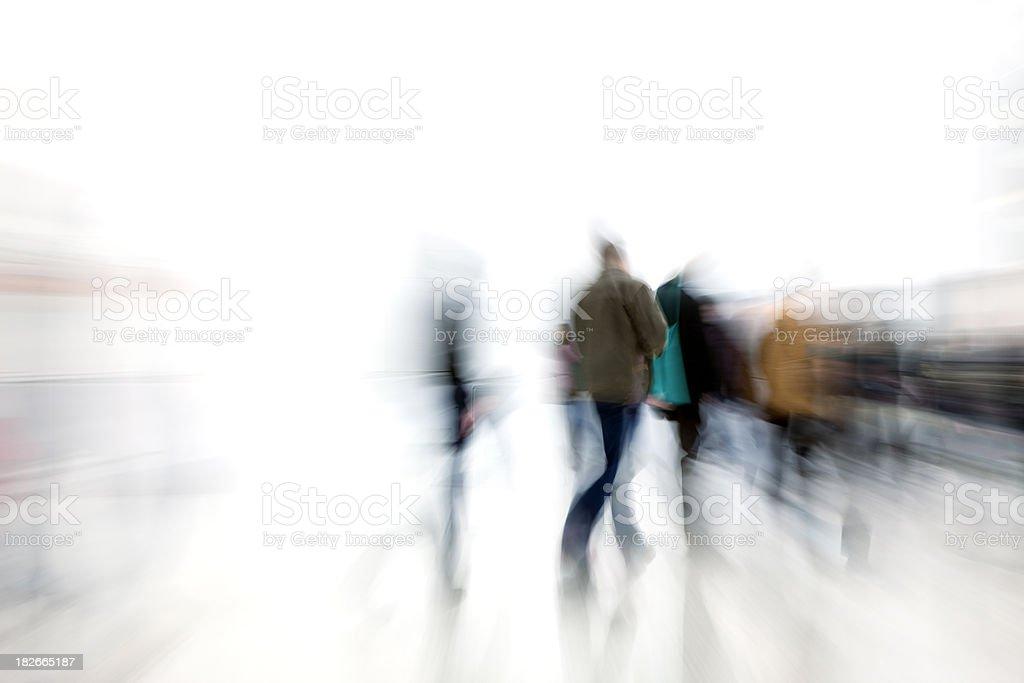 Motion blur shot of people rushing in corridor stock photo