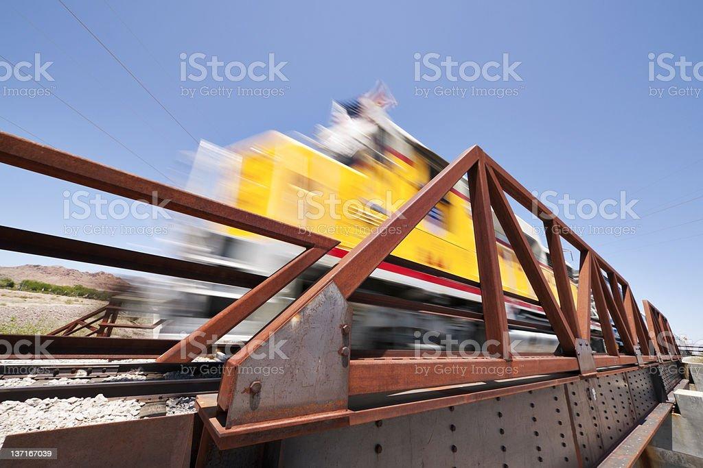 Motion Blur Train Engine on Bridge stock photo