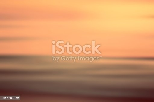 825992650 istock photo Motion blur tropical sunset beach abstract background. 537701236