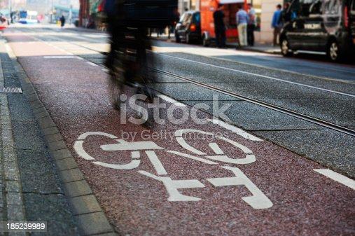 667005568istockphoto Motion blurred bicycle in bike lane 185239989