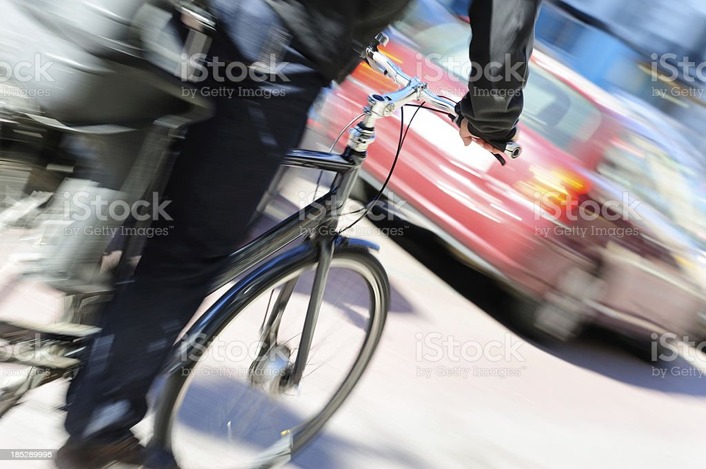 Motion blurred bike in traffic royalty-free stock photo