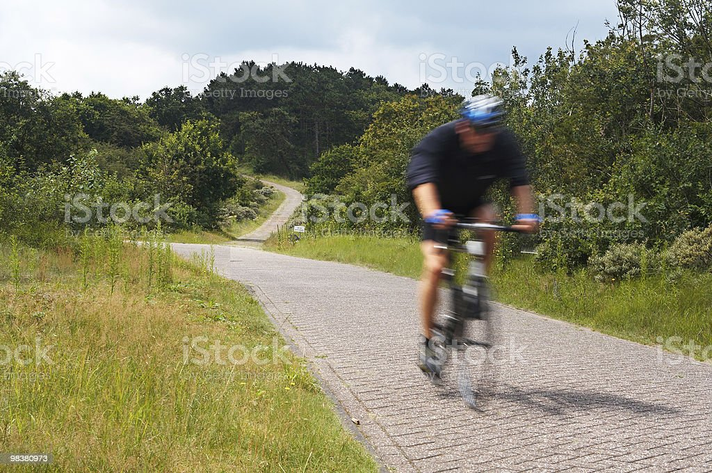 Motion blurred biker royalty-free stock photo
