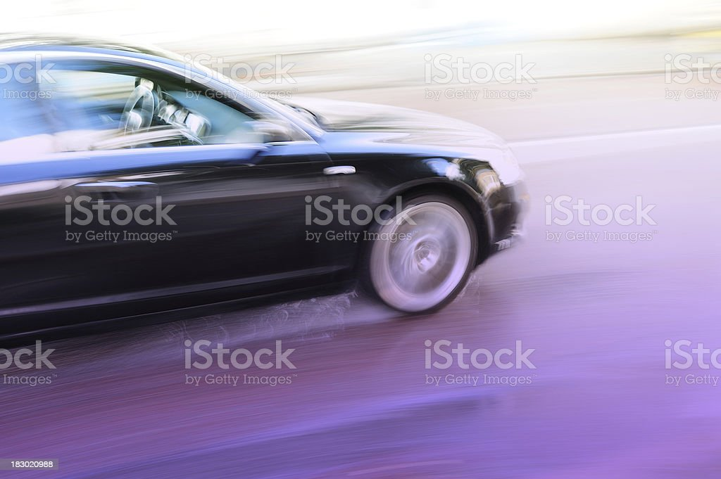 Motion blurred car driving in rain royalty-free stock photo