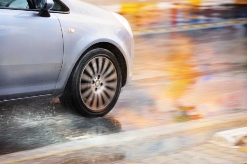 Motion blurred car driving in rain