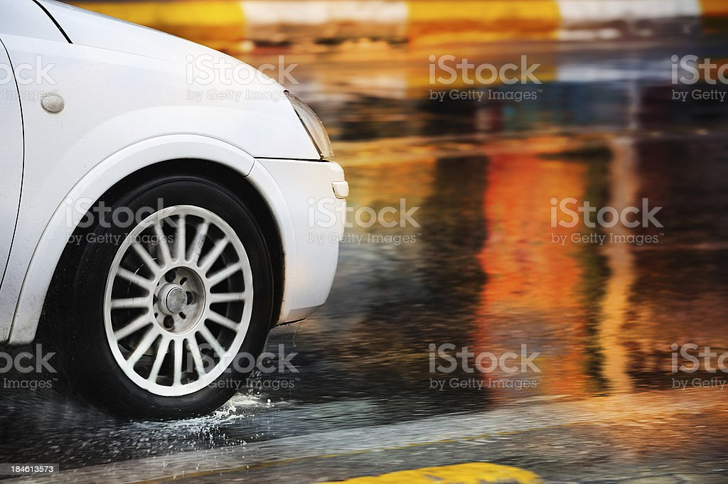 Motion blurred car driving in rain stock photo