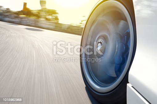 istock Motion blurred car wheel 1015962968