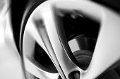istock motion blurred car wheel 165981514