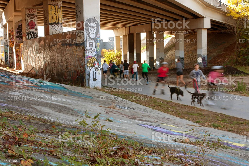 Motion Blurred Composite Of People Exercising In Urban Setting stock photo