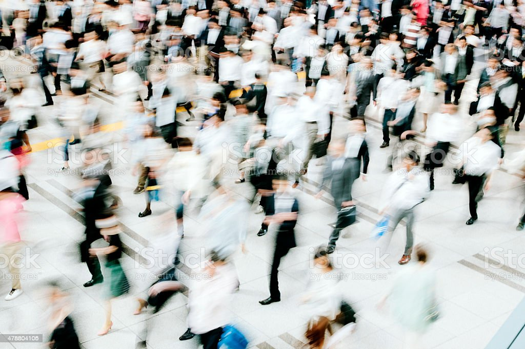 Motion blurred crowded pedestrian walkway, business people, Tokyo stock photo