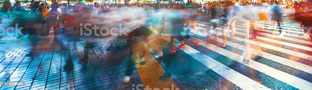 Motion blurred crowds converge at Shibuya Crossing, Tokyo, Japan - Royalty-free Asia Stock Photo