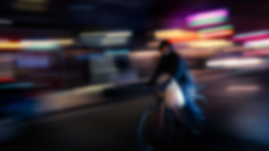 929609038 istock photo Motion blurred image of riding cyclist 1052319008