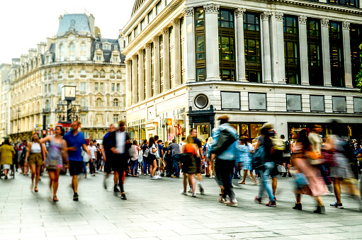 A busy street scene with crowds of motion blurred people in London's west end