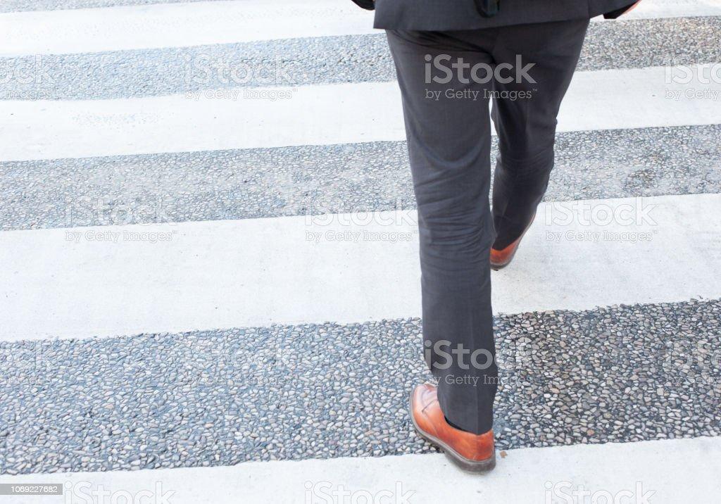 People crossing street, motion blur, on zebra crossing