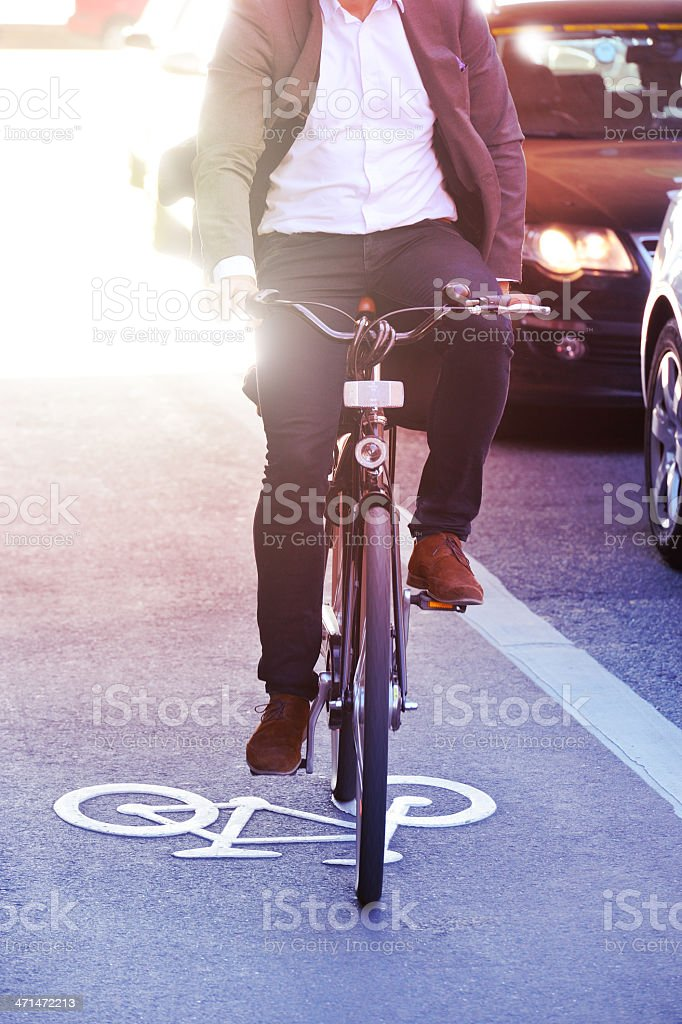 Motion blurred man on bicycle royalty-free stock photo