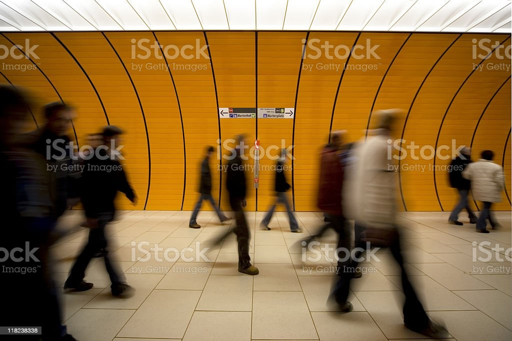 motion blurred people against moder orange tunnel royalty-free stock photo