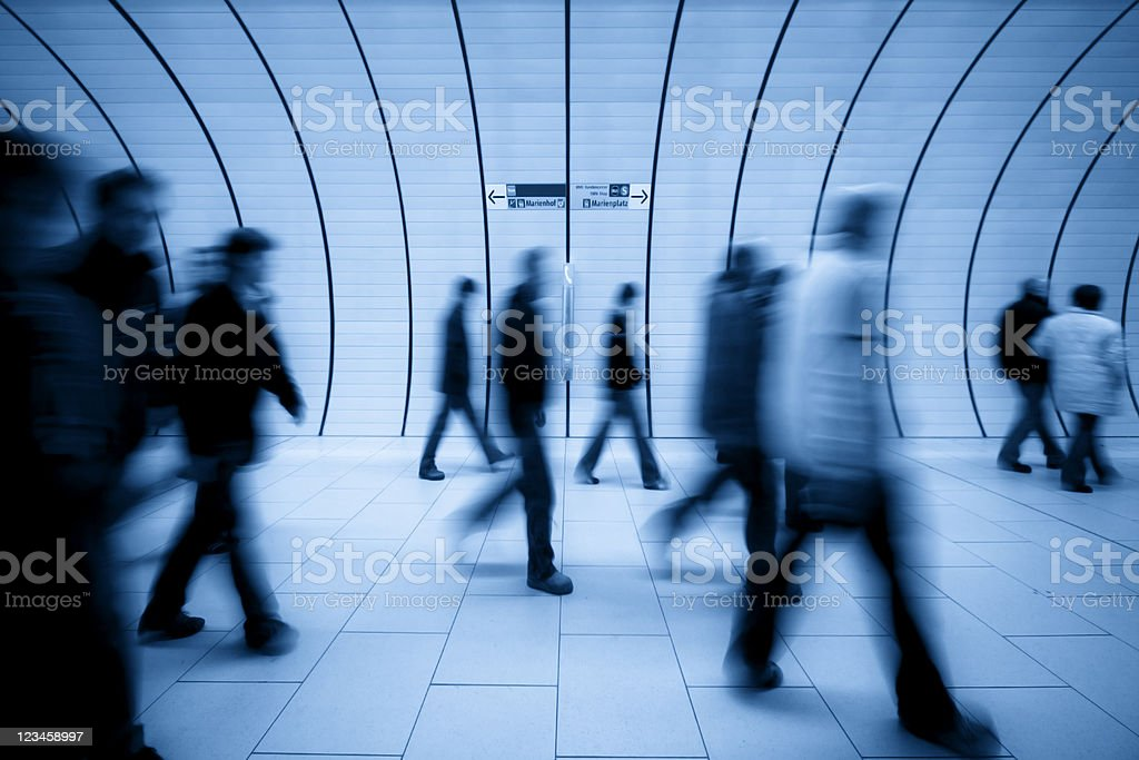 motion blurred people against modern tunnel royalty-free stock photo