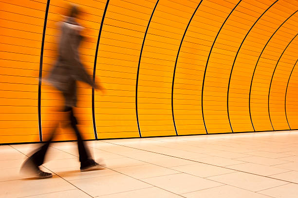 motion blurred people - perpetual motion stock photos and pictures