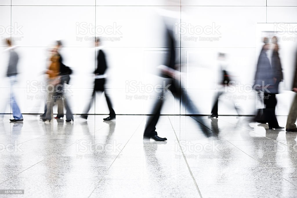 Motion Blurred People Walking Down Corridor royalty-free stock photo