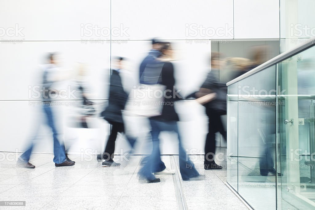 Motion Blurred People Walking in Modern Interior royalty-free stock photo