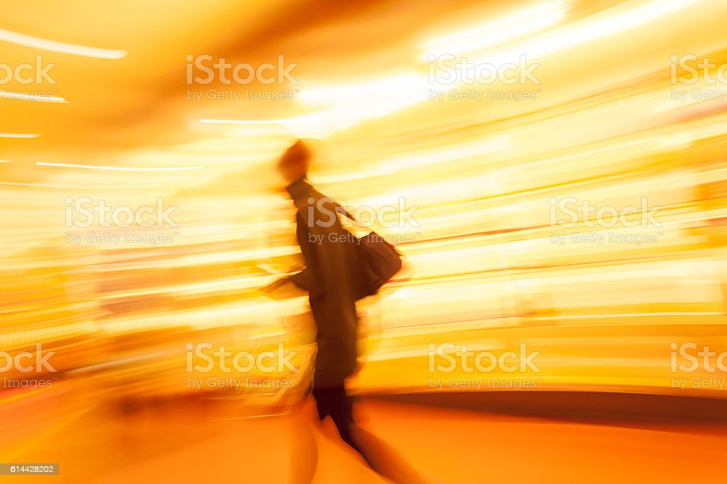 Motion Blurred Person on Illuminated Shopping Street stock photo