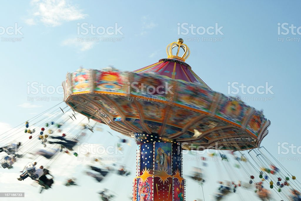 A motion blurred photo of a chairoplane royalty-free stock photo