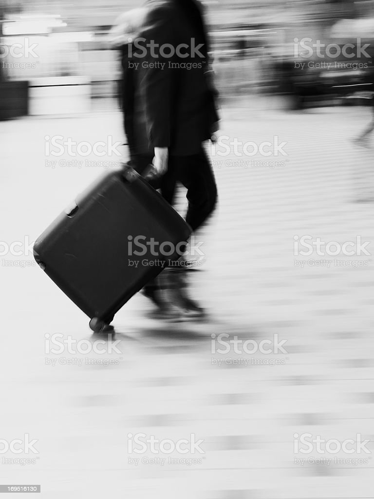 A motion blurred photo of Busy people travelling royalty-free stock photo