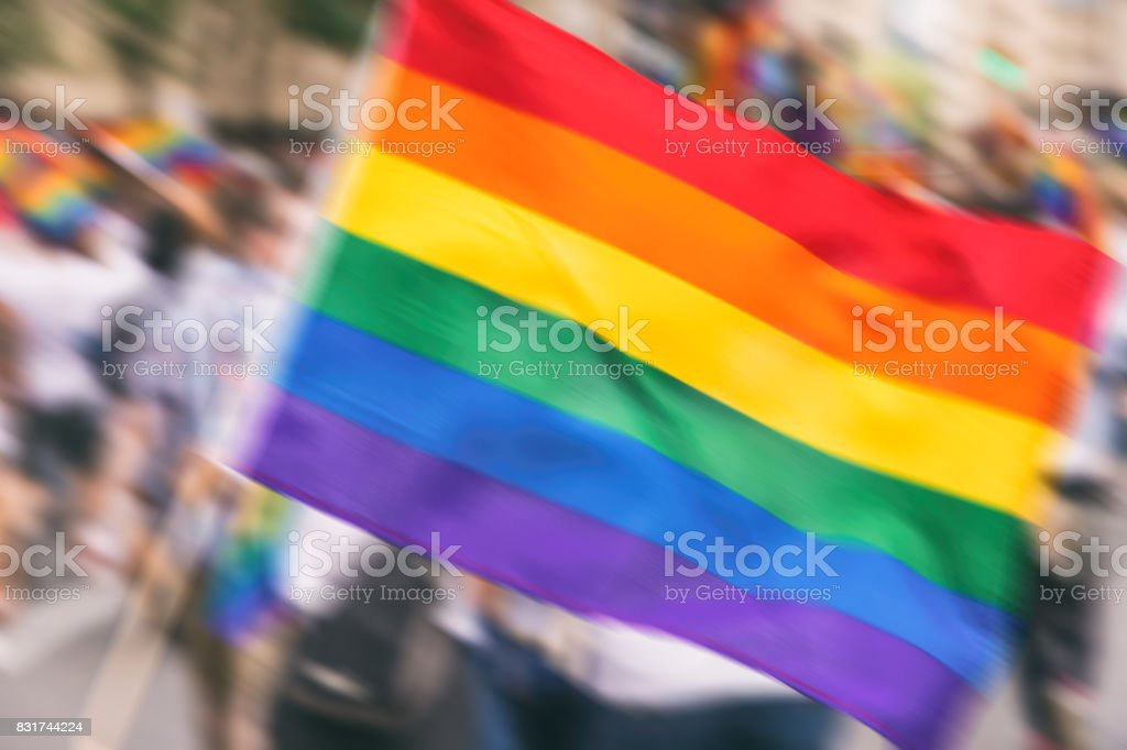 Motion blurred picture of a gay rainbow flag during pride parade. Concept of LGBT rights. stock photo