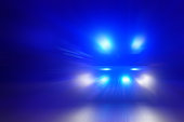 Motion blurred police car at night