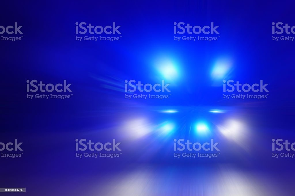 Motion blurred police car at night stock photo