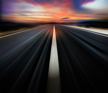 Motion Blurred Road And Dramatic Sky Stock Photo - Download Image Now