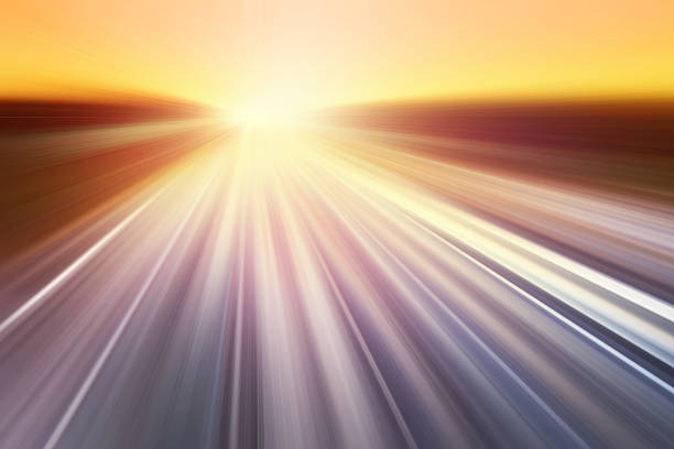 Motion blurred road at sunset. stock photo