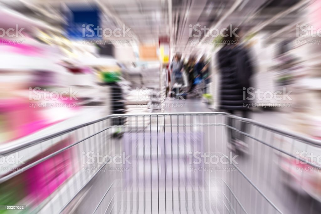 Motion blurred shopping cart in home furniture store