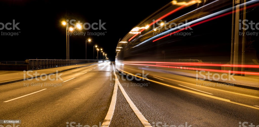 Motion blurred traffic in a road curve at night stock photo