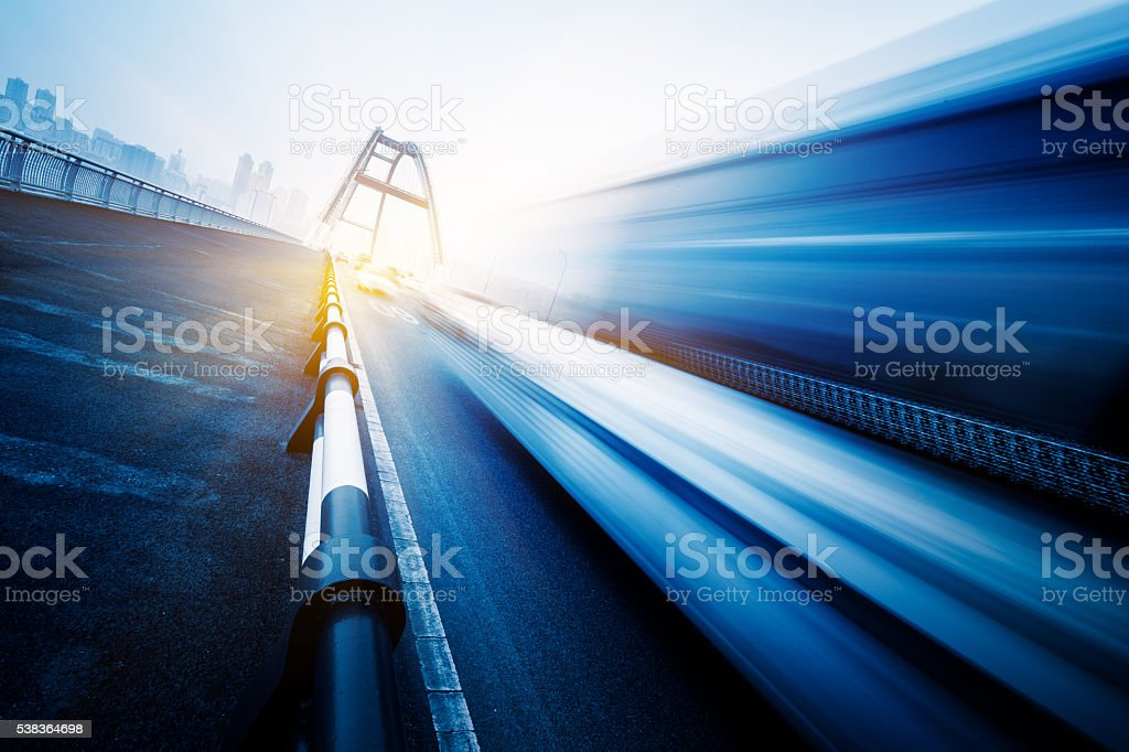 motion blurred traffic on the yangtse river bridge stock photo