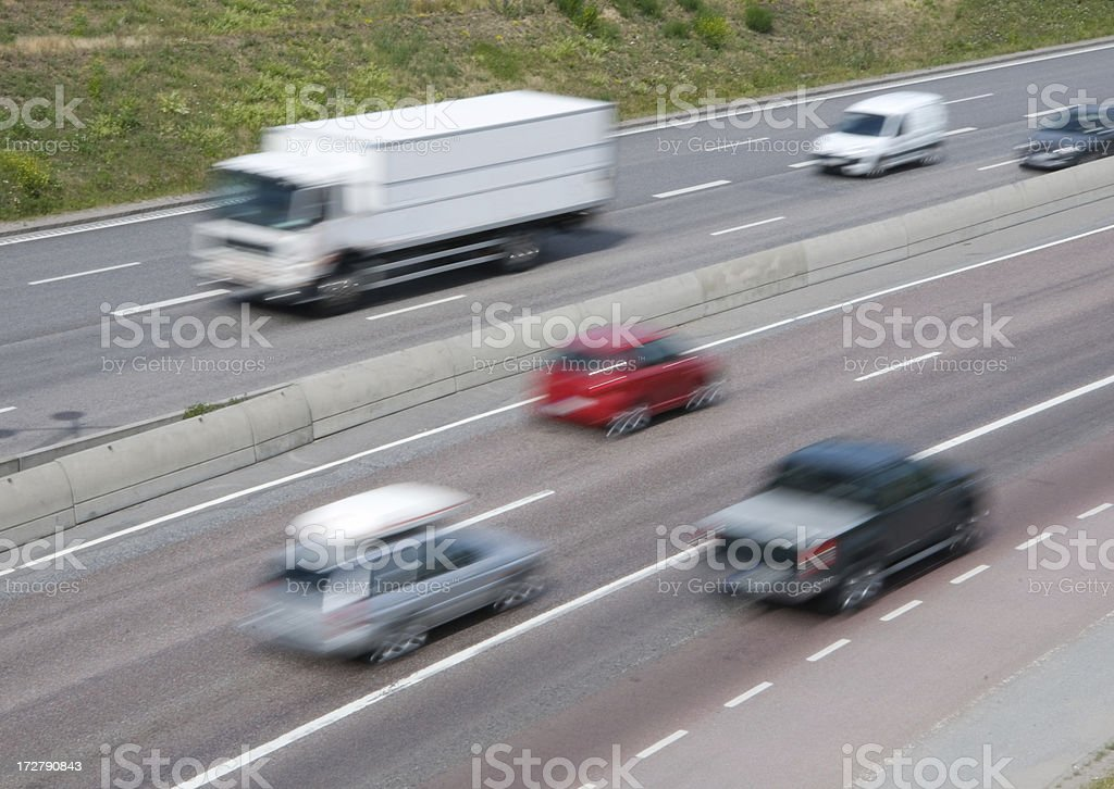 Motion blurred truck in traffic royalty-free stock photo