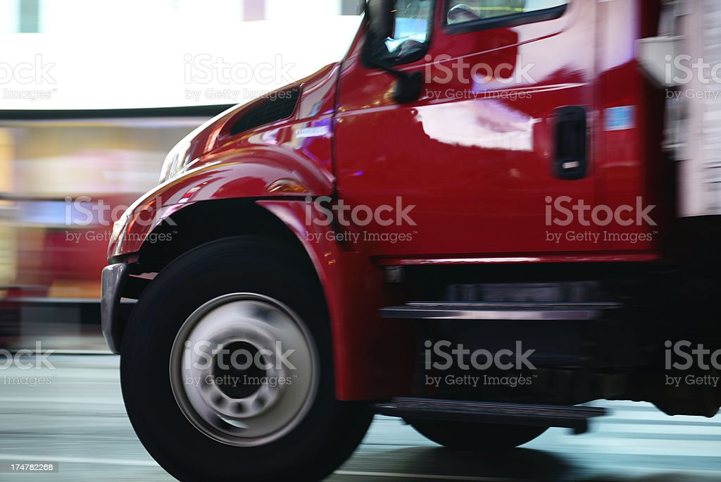 Motion blurred truck, turning royalty-free stock photo