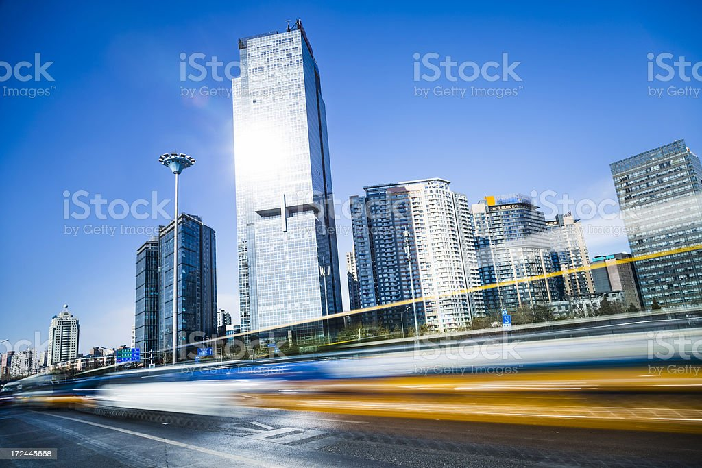 motion cars go through city by day royalty-free stock photo